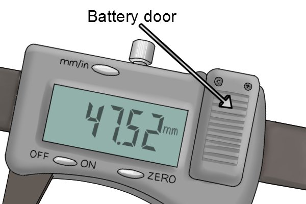 The battery in a digital caliper can usually be found behind a battery door on the front of the tool.