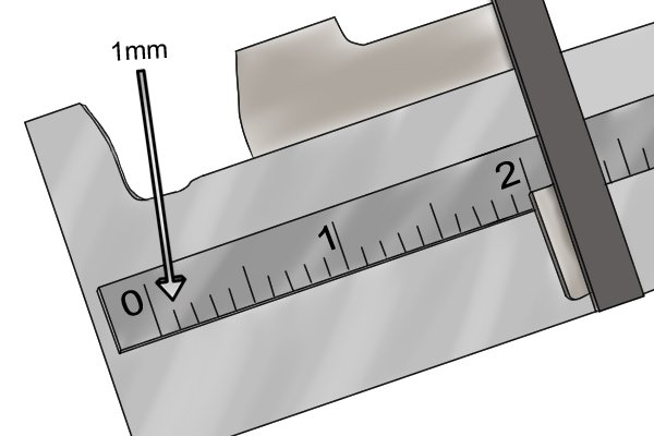 The main scale of a metric dial caliper is typically 150mm long and is divided into centimetres and millimetres.