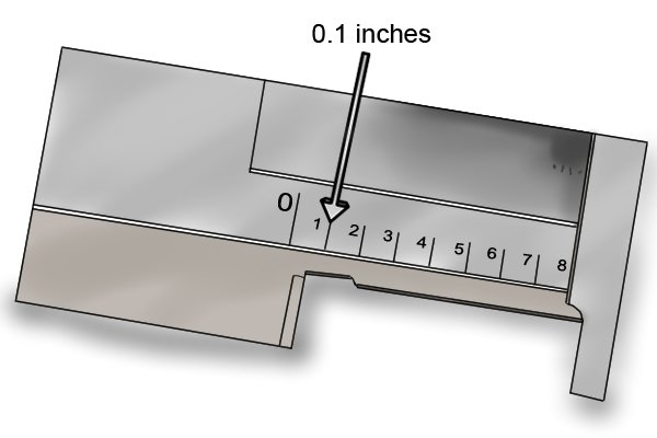 The measuring range on the beam scale is usually 6 inches, graduated in 0.1 inch increments.