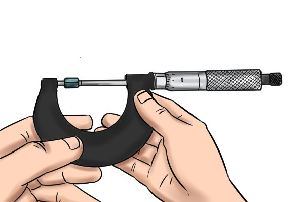 Step 3 Secure the spindle by turning the lock nut away from you. Then carefully remove the micrometer from the workpiece and take your reading.
