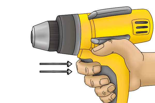 Cordless screwdriver with directional arrows showing the finger being pressed on the trigger