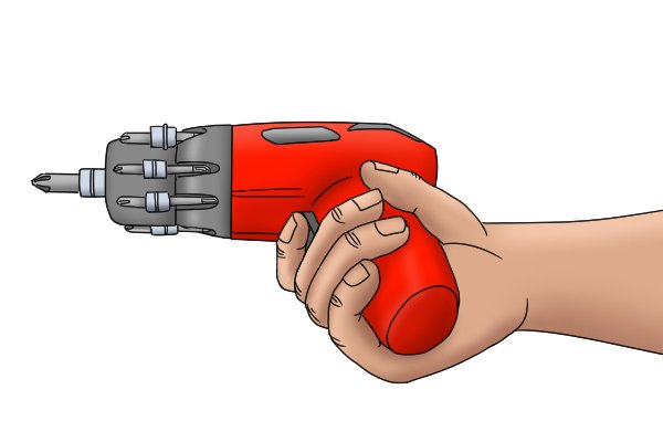 User holding cordless screwdriver with finger on trigger