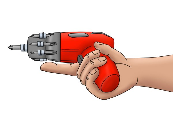 User holding cordless screwdriver with finger releasing trigger