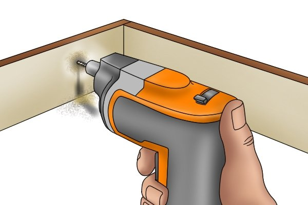Cordless screwdriver in use on plasterboard