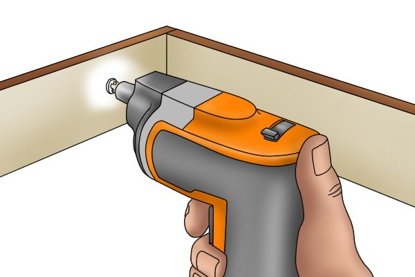 Cordless screwdriver being used in a confined space