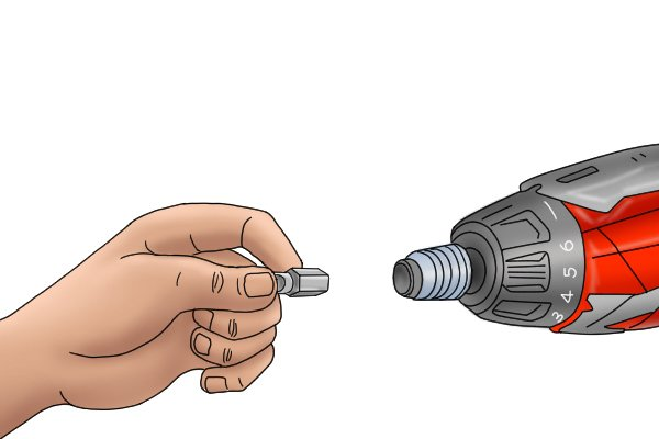 Inserting screwdriver bit into cordless screwdriver