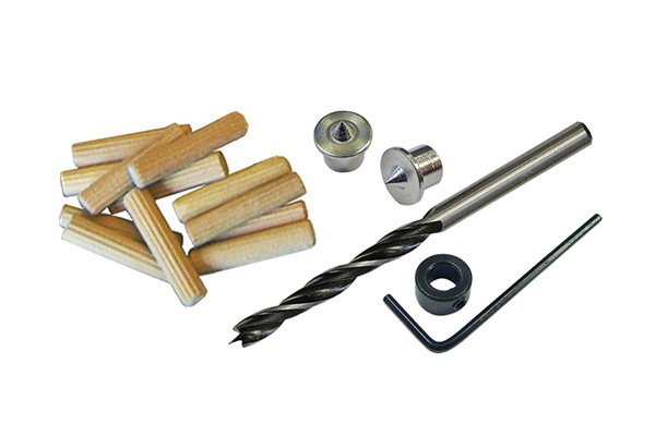 A dowelling kit containing centre points, drill stop, allen key, dowels and a brad point drill bit