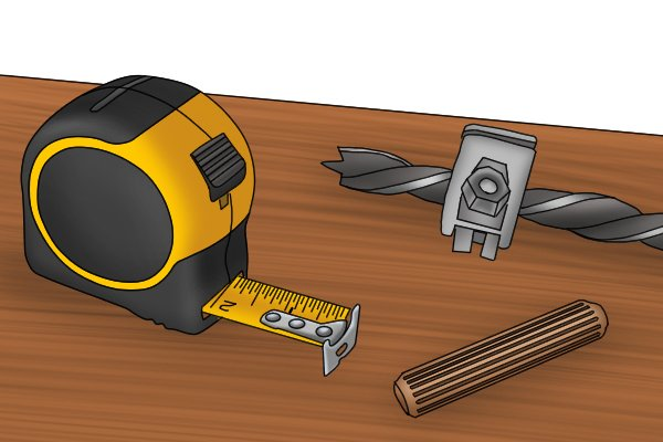 Image of a tape measure, brad point drill bit, drill stop and dowel peg for use when drilling accurate holes for dowel joinery