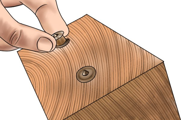 Inserting centre points into pre-drilled dowel holes to make a wooden joint