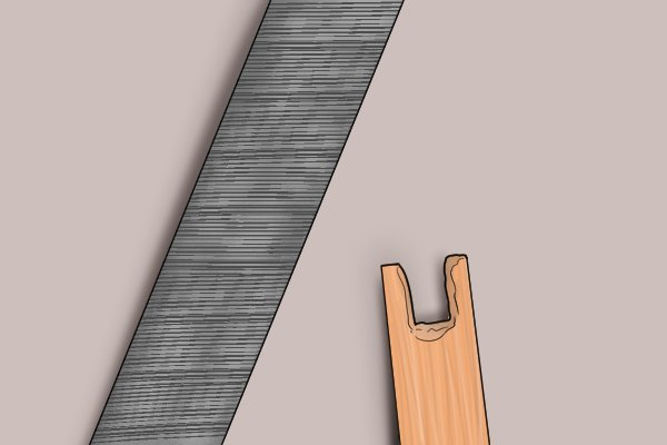 Notch cut and filed into an arrow made from a dowel rod