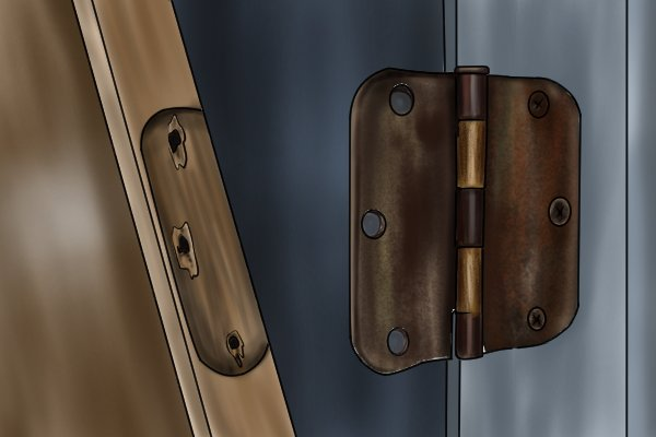 Image of stripped screw holes in a door frame that can be repaired using dowels