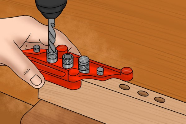 DIYer using a dowelling jig to line up a dowel hole