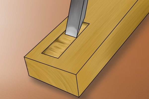 Image of a DIYer creating a mortise with a chisel which takes a lot longer than drilling a series of dowel holes and inserting dowels