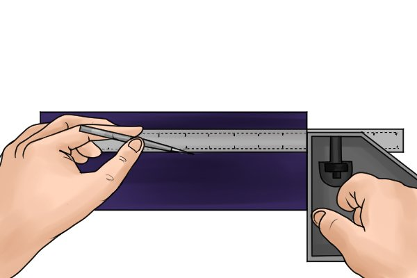 Pocket scriber being used to mark out a metal workpiece that has a covering of engineers ink