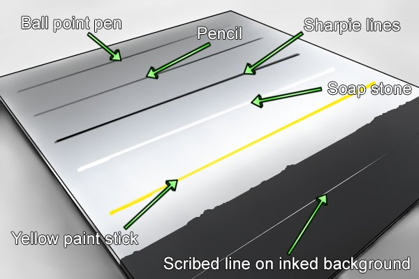 Different marking out lines on a piece of aluminium