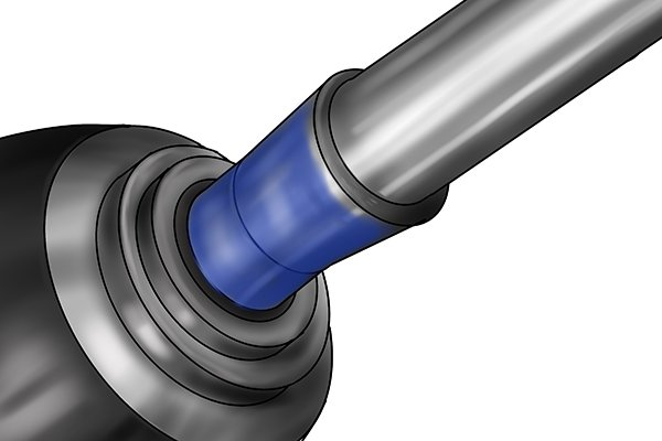 Inked master shaft being placed into a bearing