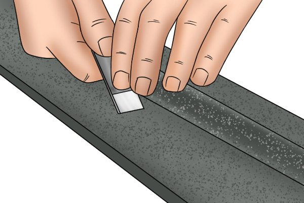 Scraping a work piece flat