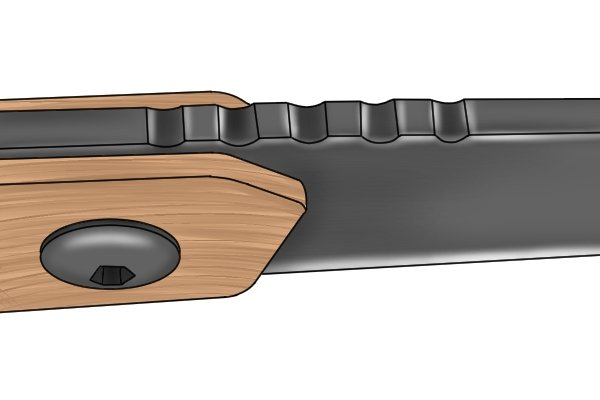 Image of jimping on a knife blade that has been created through the use of a chequering file