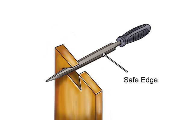 Image showing a DIYer using a barrette file to work on a narrow slot with the safe edge of the tool labelled