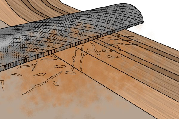 Image of a DIYer removing material quickly using a coarse carving float