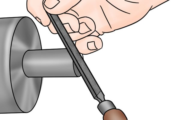 DIYer using a long angle lathe file to smooth a cylindrical object that is spinning on a lathe