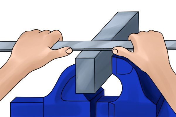 A DIYer using two hands to file aluminium.