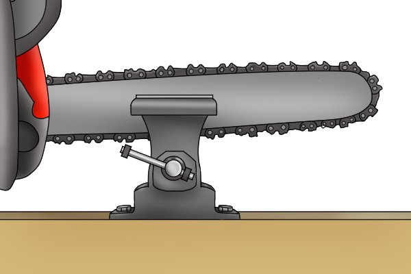 Image of a chainsaw that has been secured in a vice facing the opposite way to how it was set up during the original sharpening