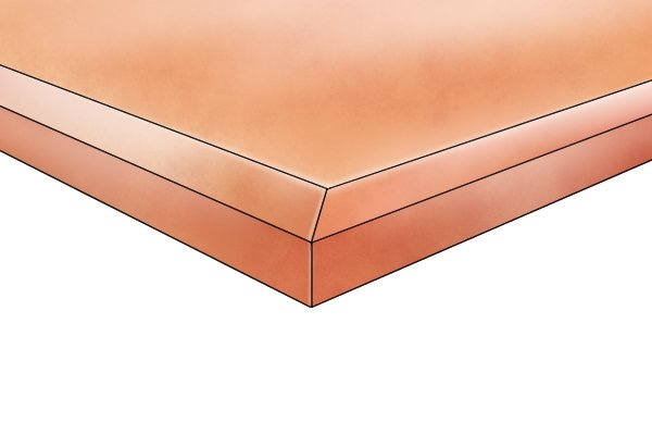 A polished stone surface with a bevelled edge