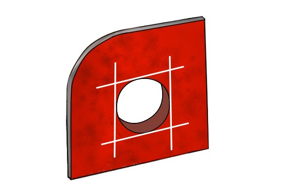 Image of a round hole that has had one corner squared off thanks to the use of a variety of different files