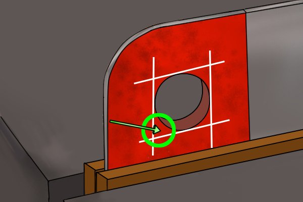 Image showing the corner of the round hole that the DIYer will be filing square filrst