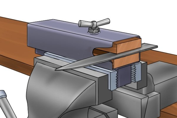 Image showing the correct way to secure a knife in a vice when jimping with a chequering file
