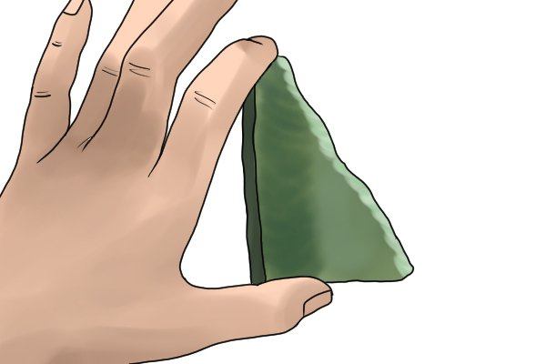 Stone age scraper made from jade used for smoothing and sharpening stone, like a file
