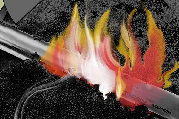 Image of the first part of the tempering process for steel, which is to heat the metal until it is red hot