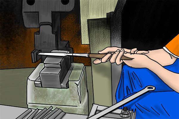 Image of a blacksmith forging a piece of metal to the right size and shape to later be turned into a file