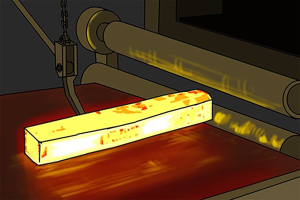 Image of a piece of steel being heated so that it can anneal, or cool slowly at room temperature. This makes the steel softer so that it is easier to work with