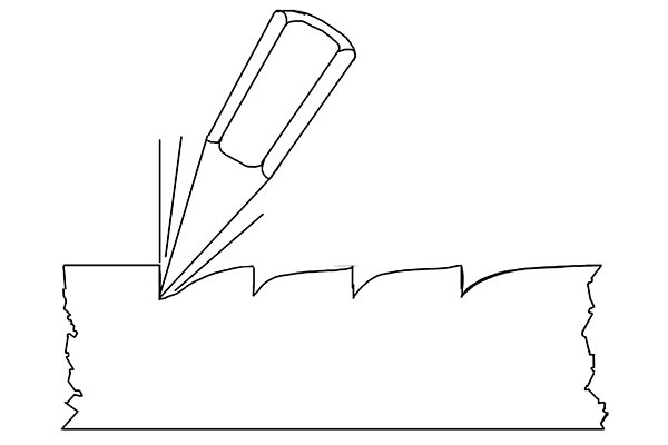 Illustration of the way a chisel is used to cut teeth into a file