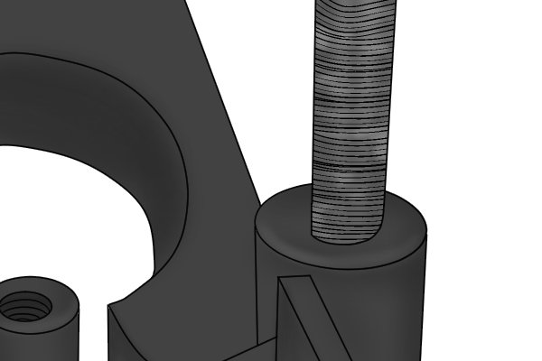 Image of a DIYer increading the diameter of a pre-drilled hole by using a round file