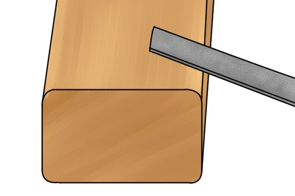 Image of a DIYer using a very small file to round corners on a large piece of wood