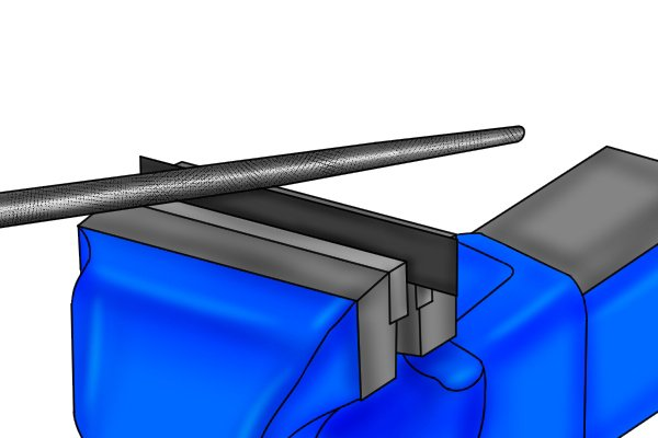 Image of a DIYer using a round file to make a semicircular groove in a piece of composite material