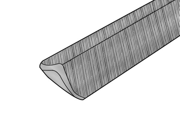 Image showing the sloping, or canting, edges of a cant saw file