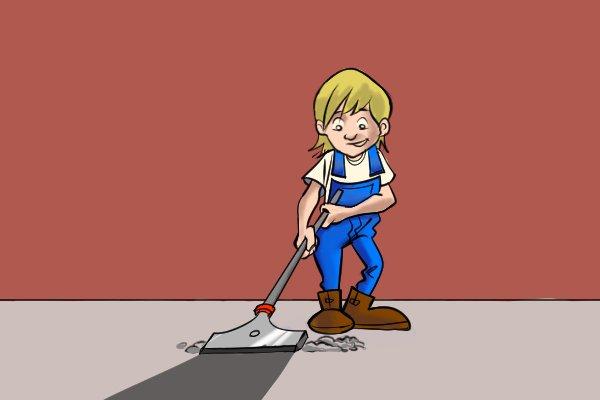 Woman using floor scraper