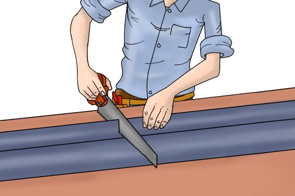 Man cutting plastic sheet with a plastic saw