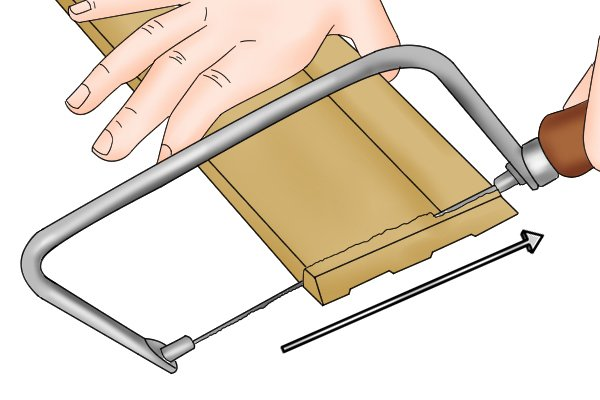 Hold the saw parallel to the work surface and rest the teeth on the material.