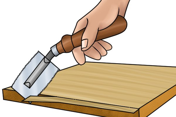 The handle on a double-sided veneer saw is angled upwards away from the blade, to allow for flush-cutting.