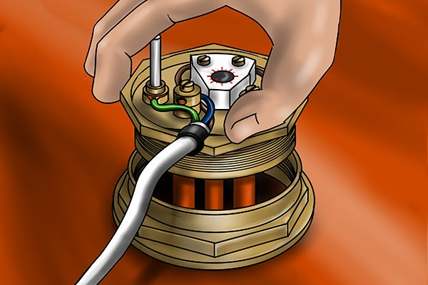 Image of a DIYer inserting a heating element into a hot water cylinder