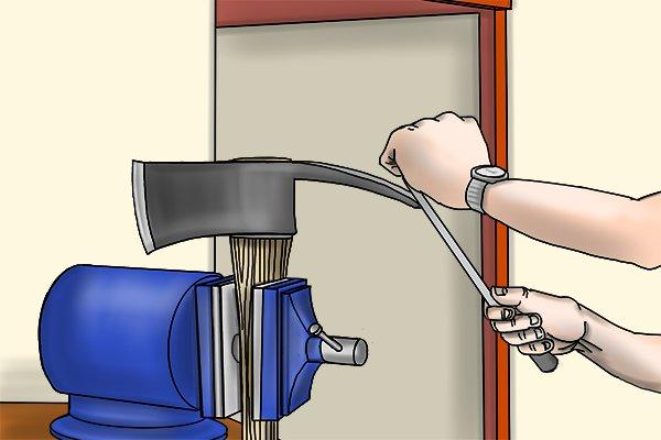 Filing a mattock axe using a hand file