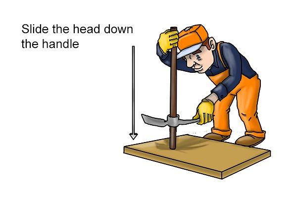 sliding on a new mattock head, slide the head down the handle