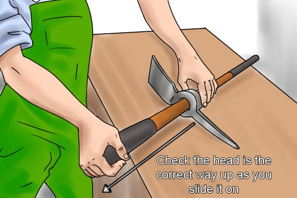 Sliding a mattock head onto the handle, Check the head is the correct way up as you slide it on
