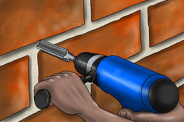 Once you have a mortar rake set up, turn the power tool on and either insert the mortar rake into the mortar or into a pre-drilled hole
