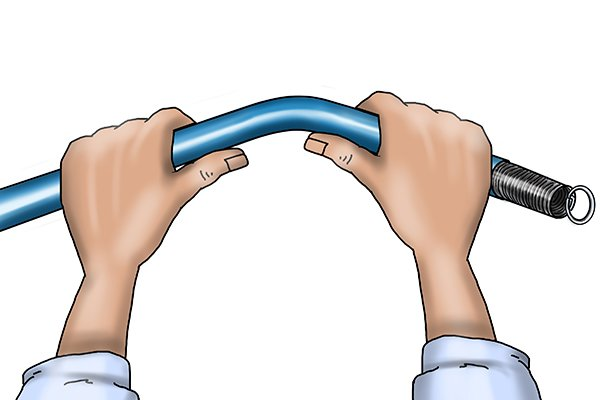 bending a plastic pipe PVC, pipe bending spring, plumbing